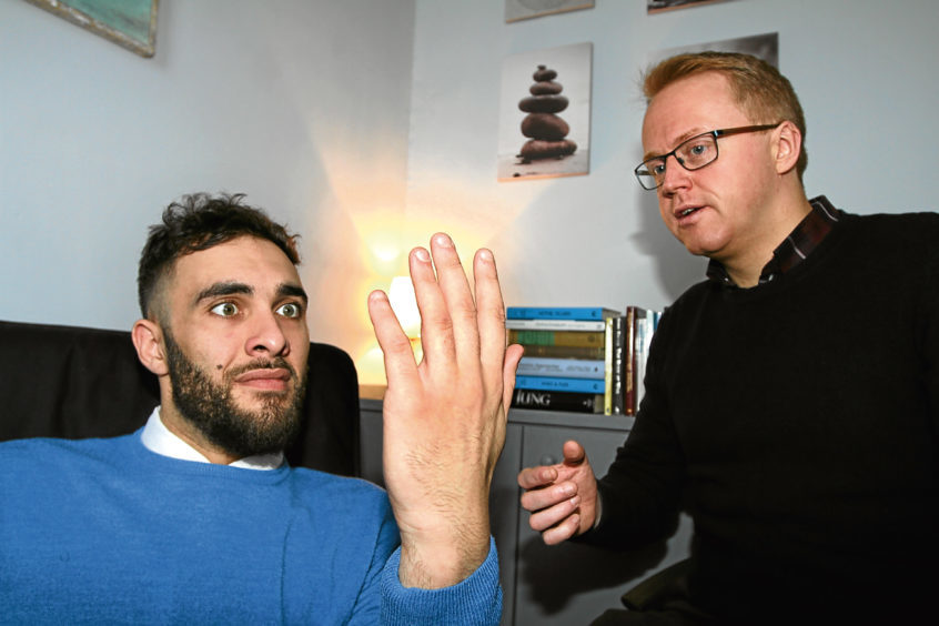 Adam has to concentrate on his hands as he begins being hypnotised by Graeme McDiarmid